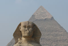 Sphinx and Chephren's Pyramid. The head of Sphinx and the Pyramid of Chephren in Giza near Cairo, Egypt. The sphinx's head is a portrait of pharaoh Chephren Royalty Free Stock Image