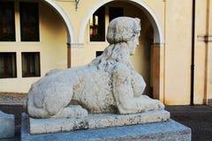 Sphinx in Cima Square, Conegliano Veneto, Italy. Sphinx statue and architecture in Cima Square in Conegliano Veneto, Treviao, Italy, Europe Royalty Free Stock Image