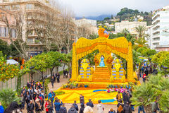 Sphinx and Cleopatra made of lemons and oranges in the famous Fete du Citron in Menton, France. MENTON, FRANCE - FEBRUARY 14, 2016: Sphinx and Cleopatra made of stock photo