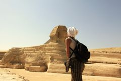 Sphinx, Egypt. Woman giving kiss stock image