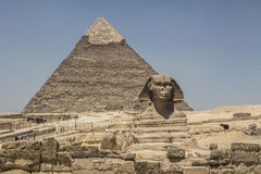 Sphinx in Egypt. The Great Sphinx of Giza, with the Pyramid of Khufu in the background Royalty Free Stock Photo