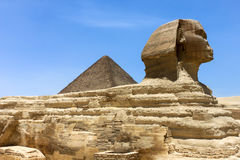 The Sphinx in Egypt with a pyramid in the background Stock Images
