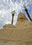 Sphinx framed by palm trees. At Luxor temple Royalty Free Stock Photos