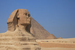 The Sphinx of Giza. The great egyptian Sphinx of Giza with ancient pyramids on the background Stock Photo