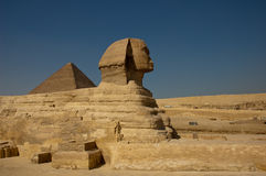 Sphinx of Giza. The Great Sphinx of Giza, with the Pyramid of Khufu in the background Stock Photo