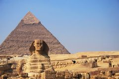 The Sphinx in Giza. The great egyptian Sphinx of Giza with ancient pyramids on the background Stock Photo