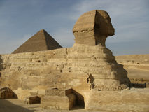 Sphinx of Giza. The great egyptian Sphinx of Giza with ancient pyramids on the background stock photography