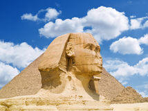The Sphinx of Giza. The Sphinx and the Great pyramid of Cheops. Egypt Series Royalty Free Stock Photo