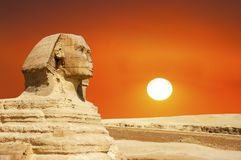 Sphinx, Giza, Cairo Egypt Travel, Sunrise, Sunset. The Sphinx ancient ruins by the Great Pyramid of Giza outside of Cairo, Egypt with a sunrise or sunset. Africa stock photo