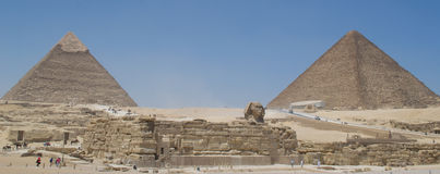 Sphinx of Giza and pyramids. Panoramics of the sphinx and pyramids of Giza Stock Photos