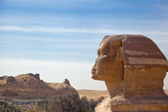 Side View of Sphinx with Rocks Stock Photo