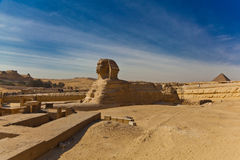 Side View of Sphinx with Rocks Royalty Free Stock Photos