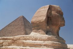 Sphinx and the Great Pyramid. In the background Royalty Free Stock Photos