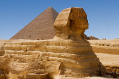 Sphinx and Great Pyramid. Of Khufu in Giza Stock Photo