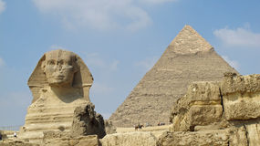 Sphinx and great pyramid Stock Image