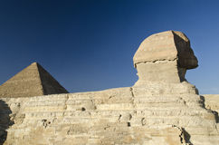 Sphinx and Great pyramid of Giza Royalty Free Stock Images