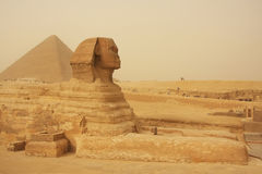 The Sphinx and Great Pyramid of Khufu in a sand storm, Cairo Stock Photo
