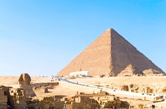 Sphinx and Khufu pyramid Stock Photos
