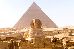 Sphinx and Khufu pyramid Royalty Free Stock Images
