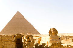 Sphinx and Khufu pyramid Royalty Free Stock Photo