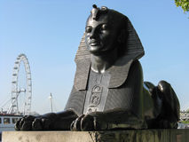 Sphinx and the London Eye on the bank of the Thames Royalty Free Stock Image
