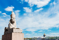 Sphinx over blue sky on Universitetskaya embankment of Neva rive Royalty Free Stock Photos