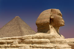 Sphinx and Pyramid. Sphinx and Cheops Pyramid. Giza, Egypt Royalty Free Stock Images