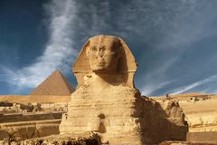 Sphinx and pyramid Stock Image