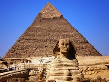 The sphinx and the pyramid. The Sphinx and a pyramid in Giza Stock Photography