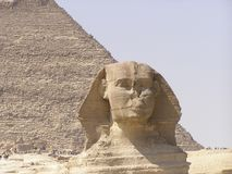 Sphinx and pyramid. Face of the Sphinx of Giza (Giseh) and Khephren pyramid Egypt, Africa royalty free stock photo