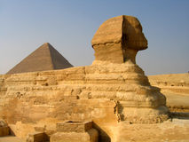 Sphinx and the pyramid of Cheops. Side shot of the Sphinx with the pyramid of Cheops in the background Stock Photo