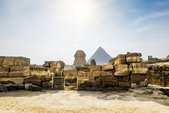 The Sphinx and the pyramid of Cheops in Giza in the background o. F a Sun Cairo Giza Stock Photo