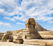 The Sphinx and the pyramid of Cheops in Giza Egipt. The Sphinx and the pyramid of Cheops in Giza in the background of a sky, Cairo, Giza Stock Images