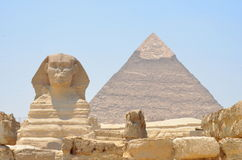 The Sphinx and Pyramid in Egypt. The wonderfull and misterious Sphinx guardian of King's valley in Gizah with the Cheope's pyramid on the back Royalty Free Stock Photos