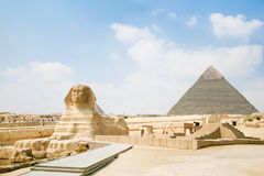 Sphinx and pyramid in Egypt Stock Photography