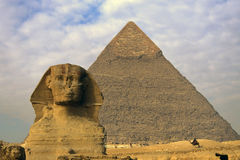 Sphinx, Pyramid and Egyptian m. An on camel, Gisa, Egypt Royalty Free Stock Image