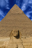 Sphinx and pyramid of Gizeh Stock Photos