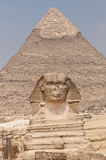 The Sphinx and the  Pyramid of Khafre. The Sphinx and the  Pyramid of Khafre in line in the background Royalty Free Stock Photography