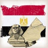 Sphinx pyramid på den Egypten flaggan Royaltyfria Bilder