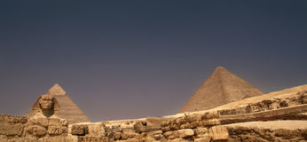 Sphinx and Pyramids of Giza. Sphinx with Chephren and Cheops pyramids, Gyza, Egypt Royalty Free Stock Photos