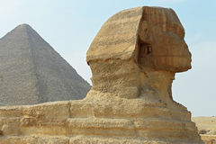 Sphinx statue and Pyramid in Giza Egypt. Ancient architecture Stock Photos