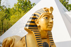 Sphinx statue with white pyramid Royalty Free Stock Photography