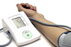 Sphygmomanometer and arm Royalty Free Stock Photo