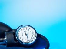 Sphygmomanometer on blue Royalty Free Stock Photos