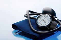 Sphygmomanometer on blue background Royalty Free Stock Photography