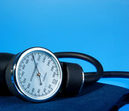 Sphygmomanometer on blue background Stock Photos
