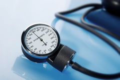 Sphygmomanometer on blue background Stock Photography