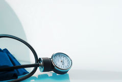 Sphygmomanometer on blue background Royalty Free Stock Image