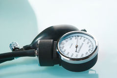 Sphygmomanometer on blue background Royalty Free Stock Photos