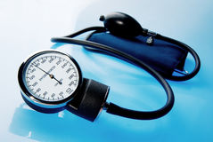 Sphygmomanometer on blue background Royalty Free Stock Photo